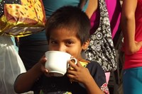 Son of cocoa farmer enjoying a chocolate drink
